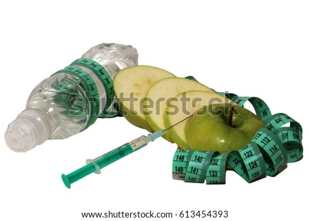 Healthy lifestyle, apple and centimeter tape, syringe and water