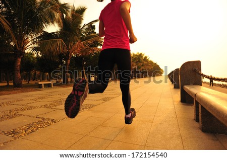 healthy lifestyle beautiful asian woman running at  sunrise seaside  - stock photo