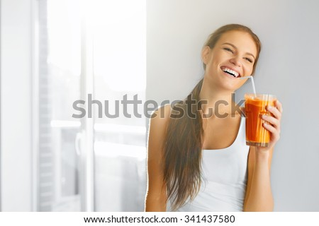 Healthy Lifestyle. Closeup Of Beautiful Smiling Vegetarian Woman Drinking Fresh Raw Detox Vegetable Juice. Healthy Food Eating, Diet And Lifestyle Concept. Drinks. Beauty Concept. - stock photo