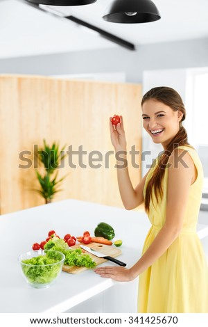 Healthy Lifestyle. Closeup Woman Cutting Fresh Organic Vegetables On A Wooden Board In Kitchens. Salad, Food Preparation. Healthy Eating, Diet Concept. Nutrition. - stock photo