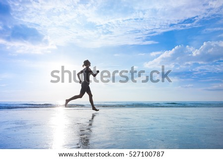 Healthy lifestyle concept, woman are jogging at sea beach at sunrise time, cardio training
