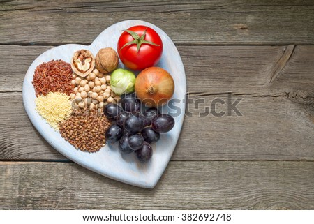 Healthy lifestyle diet concept with heart  and food on vintage boards - stock photo