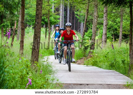 Healthy lifestyle - family biking - stock photo