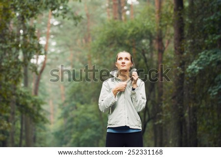 healthy lifestyle fitness sporty woman running early in the morning in forest area, fitness healthy lifestyle concept - stock photo
