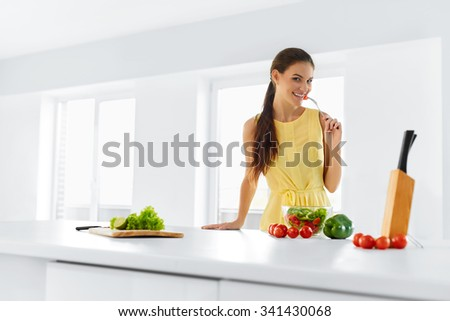 Healthy Lifestyle. Happy Smiling Caucasian Woman Eating Fresh Organic Green Vegetarian Food. Dieting, Diet, Health And Beauty Concept. Nutrition. - stock photo