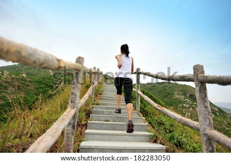 healthy lifestyle sports woman running on mountain stairs  - stock photo
