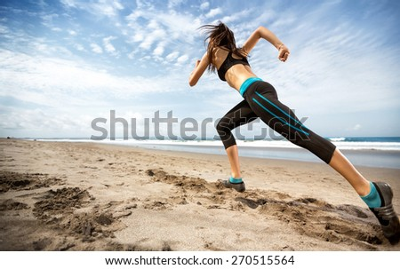 healthy lifestyle sports woman running on seaside, motion blur - stock photo