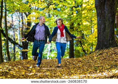 Healthy lifestyle - woman and man running in park - stock photo