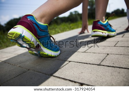 Healthy lifestyle, Woman fitness and Runner feet running - stock photo