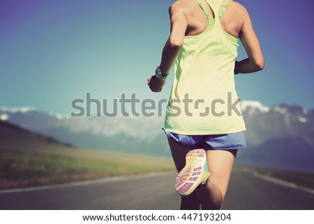 healthy lifestyle young fitness woman runner running on road - stock photo