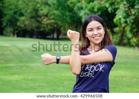 healthy lifestyle - Young happy woman in green field public park relaxing action, fresh relax exercise asian girl, lose weight