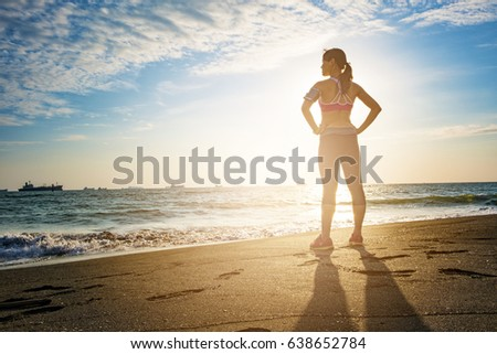 healthy lifestyle young woman runner running on sunrise