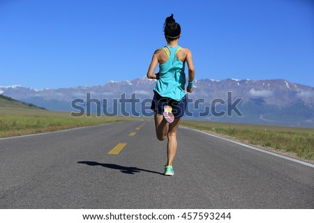 healthy lifestyle young woman runner running on trail - stock photo
