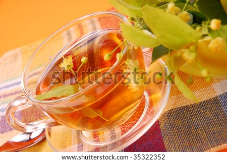 healthy linden tea on orange background