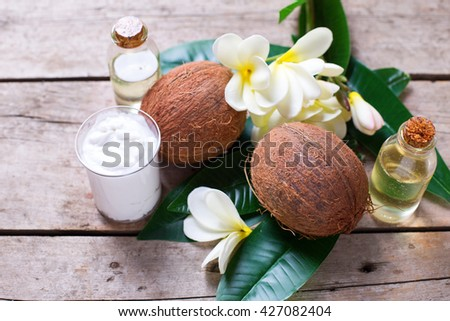 Healthy living. Coconuts,  coconut oil and milk on  vintage wooden background. Selective focus.  Natural organic spa products.
