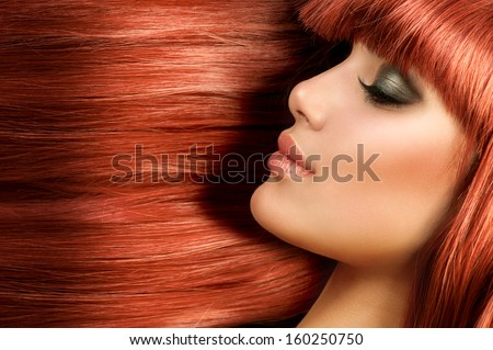 Healthy Long Straight Hair. Red Hair Model Girl Portrait. Sexy Woman Face with Long Shiny Straight Red Hair. Fringe Hairstyle. Hair Extensions - stock photo