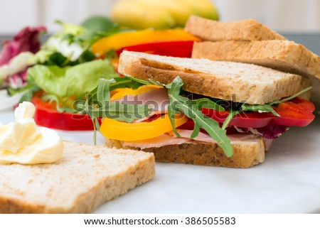Healthy lunch food sandwich with turkey and ham on a plate
