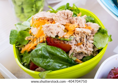healthy lunch of tuna salad with cherry tomatoes and spinach