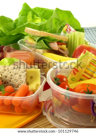 Healthy lunch prepared in small plastic containers