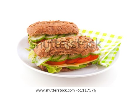 Healthy lunch with brown wholemeal bread rolls with cereals and vegetables - stock photo