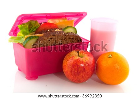 Healthy lunch with whole meal bread cheese fruit and milk - stock photo