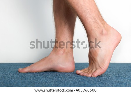 Healthy male feet feeling comfortable at home. - stock photo
