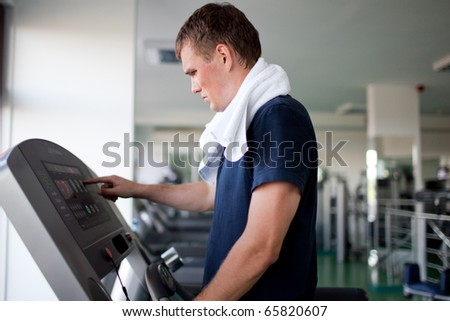 Healthy man a treadmill in a sport center