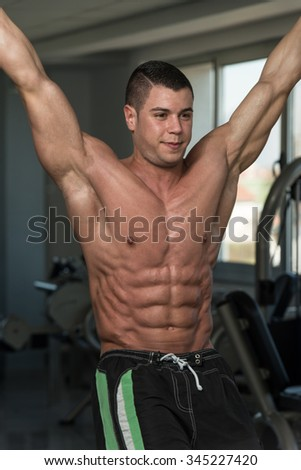 Healthy Man Exercising His Abs At The Gym - stock photo