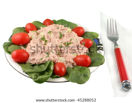 Healthy meal of tuna fish salad with cherry tomatoes and spinach on a white background - stock photo