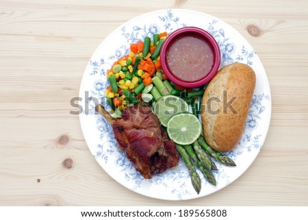 healthy meal with grilled pork and vegetable - stock photo
