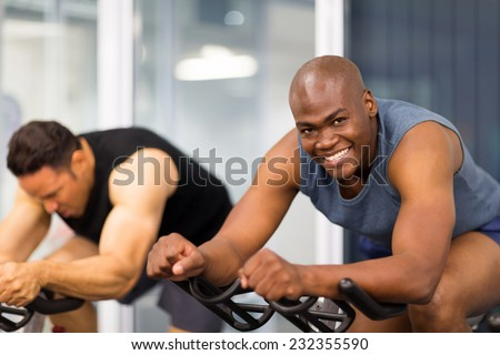 healthy men on gym bike - stock photo