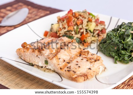 Healthy menu - delicious grill Salmon with side dishes - stock photo