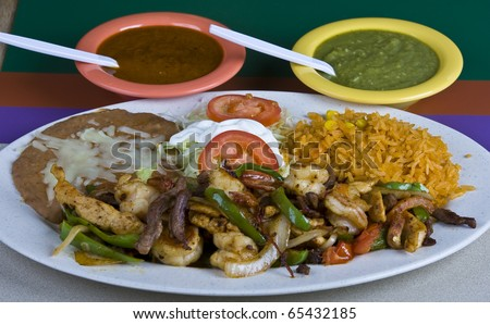 Healthy mexican meal,fajitas and vegetables and rice and beans on plate