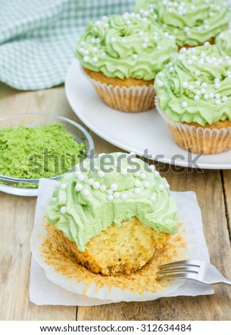 Healthy muffins with ricotta cheese and matcha frosting - stock photo