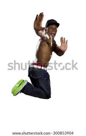 Healthy muscular black man jumping isolated on a white background. He is shirtless and wearing hip hop style jeans. - stock photo