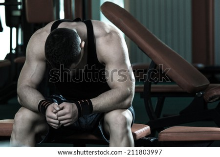 Healthy muscular young man after a workout