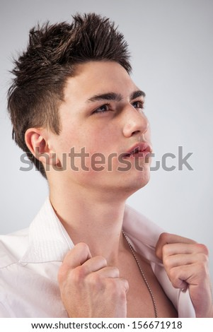 Healthy muscular young man. Isolated on grey background.