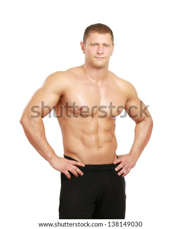 Healthy muscular young man. Isolated on white background - stock photo