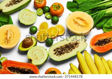 Healthy Nutrition. Fresh Organic Vegetables And Fruits ( Bok Choy, Papaya, Salad, Persimmon, Avocado, Lime, Bananas , Melon, Guava, Oranges ). Food Ingredients Background. Vegetarian, Vitamins Concept - stock photo