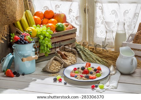 Healthy oat flakes with fresh fruits for breakfast - stock photo