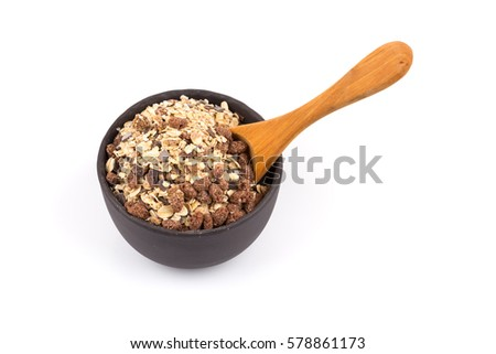 Healthy oat granola muesli cereals with chocolate in a scoop and bowl on white