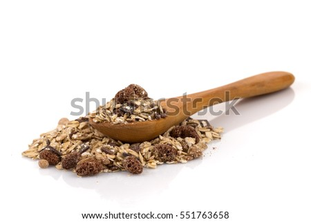Healthy oat granola muesli cereals with chocolate in a spoon on white