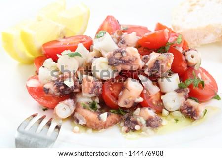 healthy octopus salad- traditional dish from Portugal-Santa Luzia, Algarve - stock photo