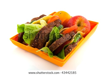 Healthy open lunch box filled with bread for take away - stock photo