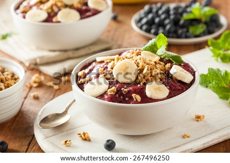 Healthy Organic Berry Smoothie Bowl with Granola and Fruit - stock photo