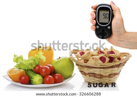healthy organic food, cookiesand a female hand holding a blood glucose meter with figures 9.0 on a white background