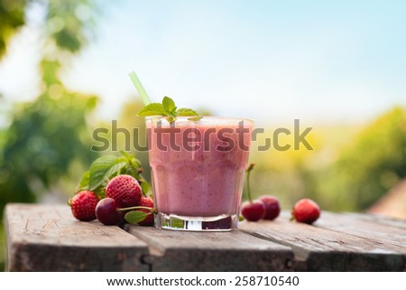 Healthy organic food. Strawberry fruit drink smoothie - stock photo