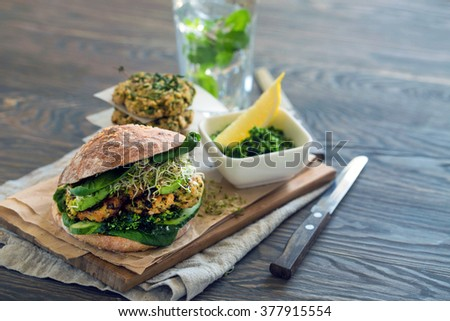 Healthy organic food: Vegan sourdough burger with sprouted greens and chickpea rissole - stock photo