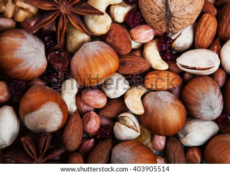 healthy organic mix of nuts and cranberries - food background