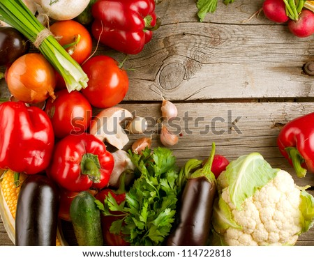 Healthy Organic Vegetables on a Wooden Background. Art Border Design - stock photo